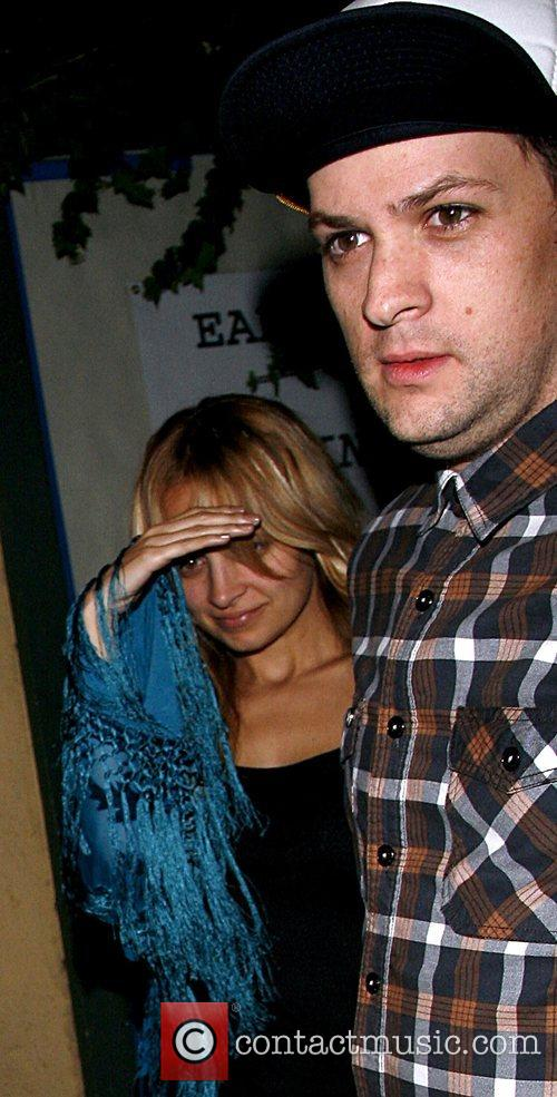 Nicole Richie tries to hide from the photographers...