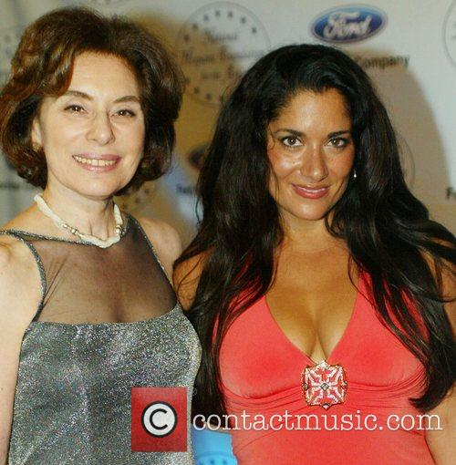 Yvonne Delarosa and Guest attends the black tie...