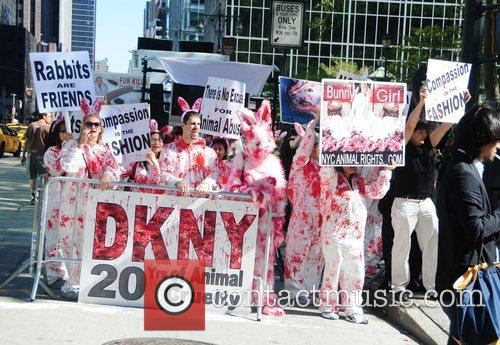 Animal rights activists protest outside the DKNY fashion...