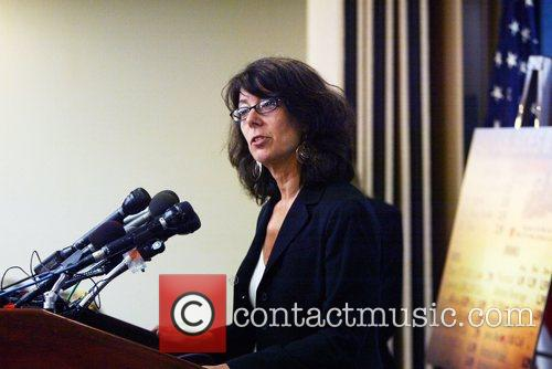 Cathy Nonas holding a news conference to release...