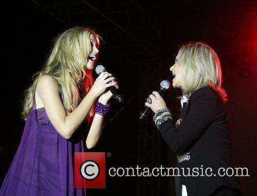 Delta Goodrem and Olivia Newton-John performing live at...