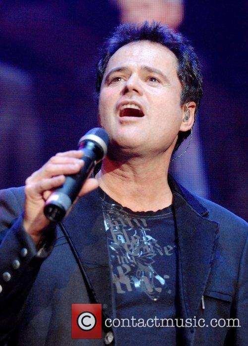 Donny Osmond perform during their 50th anniversary tour...