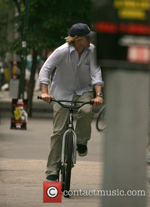 Riding his bike through Soho