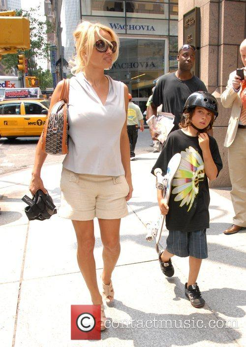 Takes her son Dylan on a stroll through...