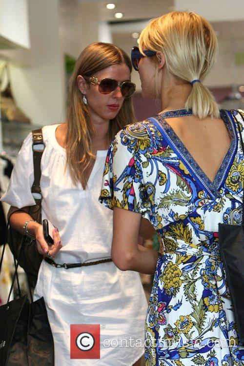 Paris Hilton and her sister Nicky Hilton shopping...