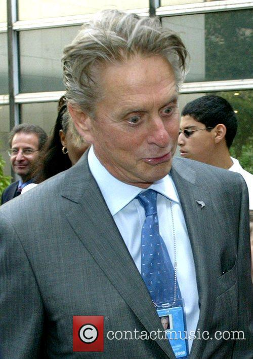 Michael Douglas attending the 'Ringing of The Peace...