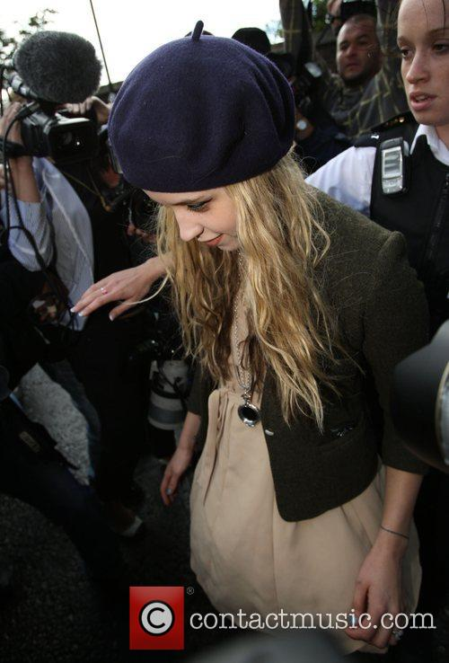 Leaving home amid the media frenzy surrounding her...
