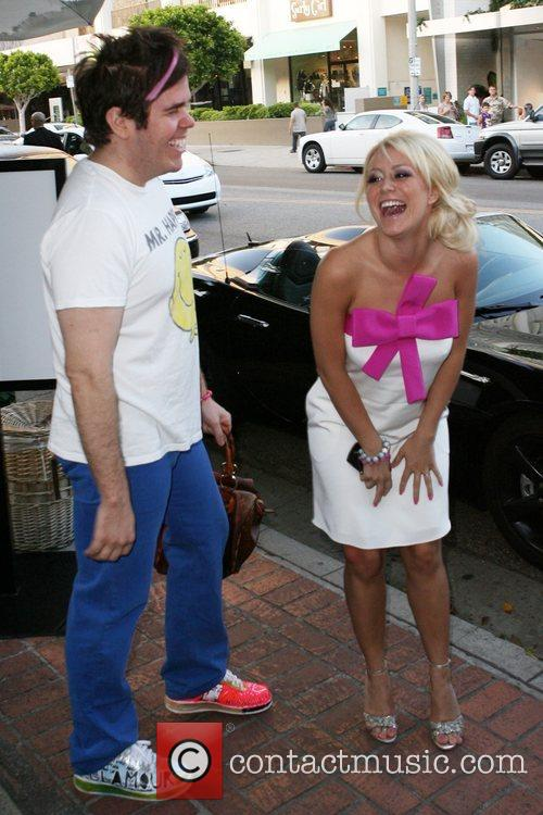Perez Hilton and a friend outside the Ivy...