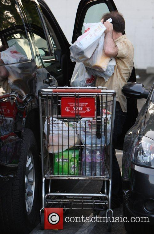 A helper trolleys over the shopping for Peter...