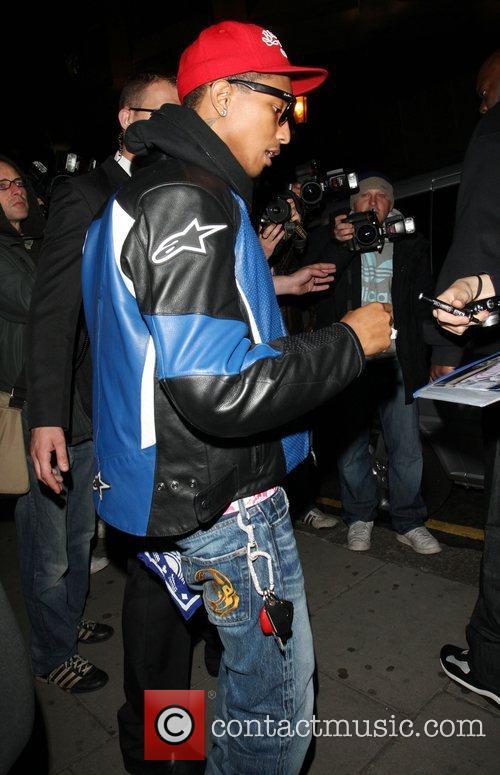 Pharrell Williams leaves Harvey Nichols wearing a diamond...