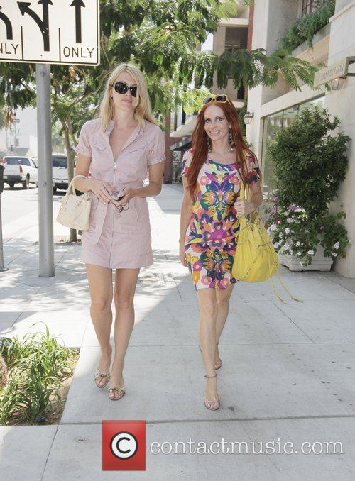 Meredith Ostrom and Phoebe Price stroll through the...