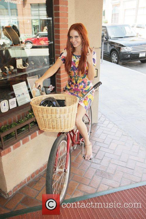 Phoebe Price shows off her bicycle Los Angeles,...