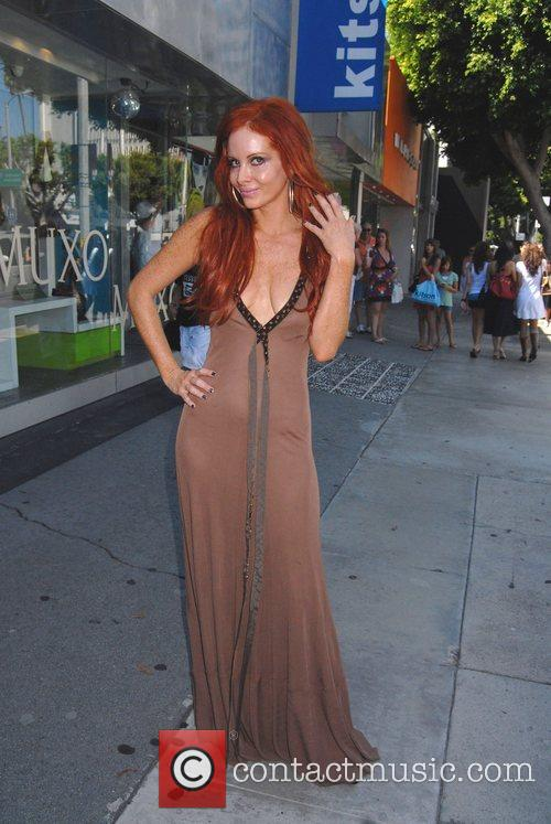 Phoebe Price shows of her fresh tan while...