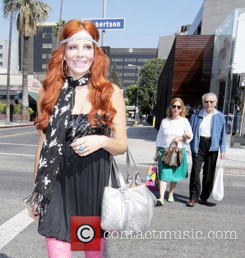 Pheobe Price  walking on Robertson Blvd. wearing...