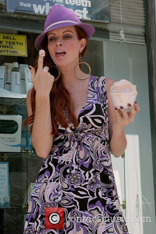 Phoebe Price enjoys a caramel frozen yogurt at...