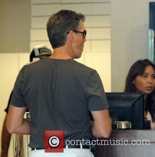 Pierce Brosnan shops for sunglasses after having lunch...