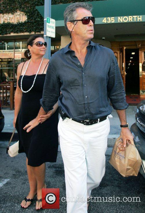 Pierce Brosnan and wife Keely Shaye Smith outside...
