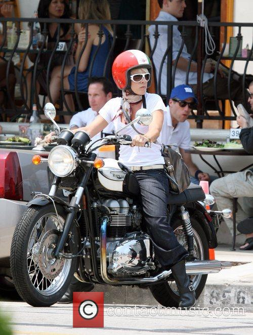 Pink on her motorcycle after having lunch at...