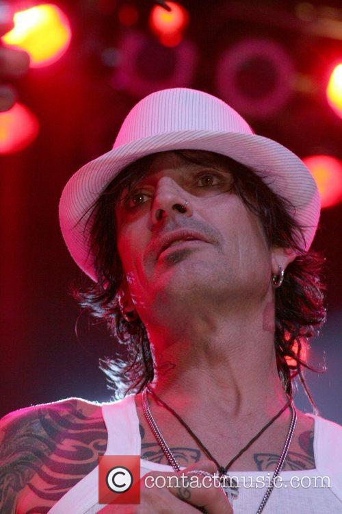 Tommy Lee perform at the Premiere of Discovery...
