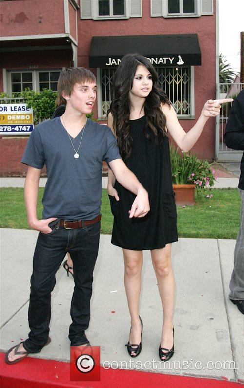 Selena Gomez and guest leaving the Pop Factory...