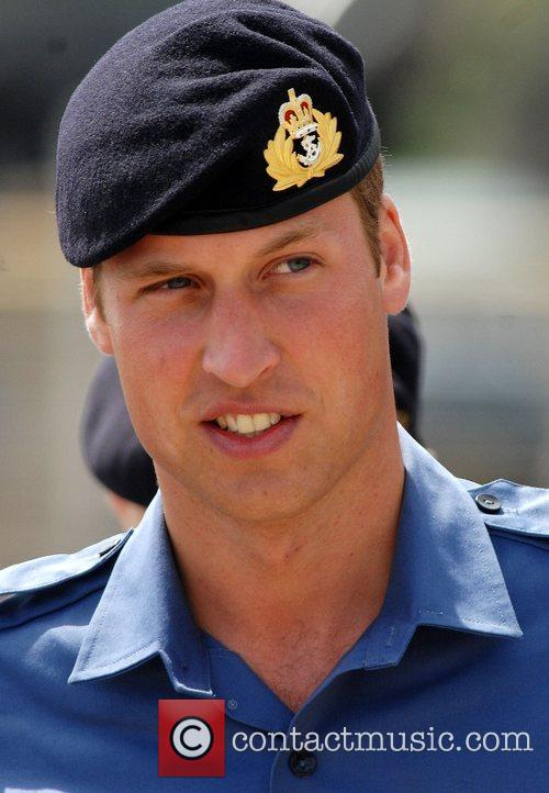 Prince William looks on during training with the...