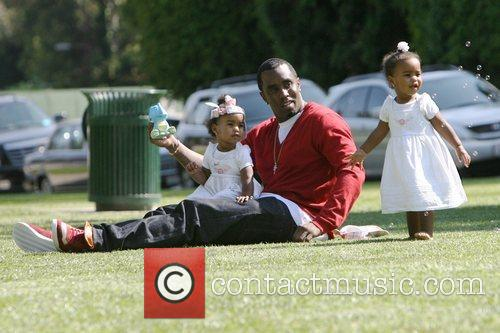 Sean 'P. Diddy' Combs  plays with his...