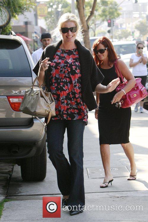Rebecca Romijn 4