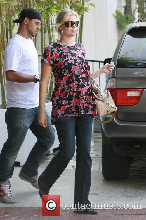 Rebecca Romijn 11