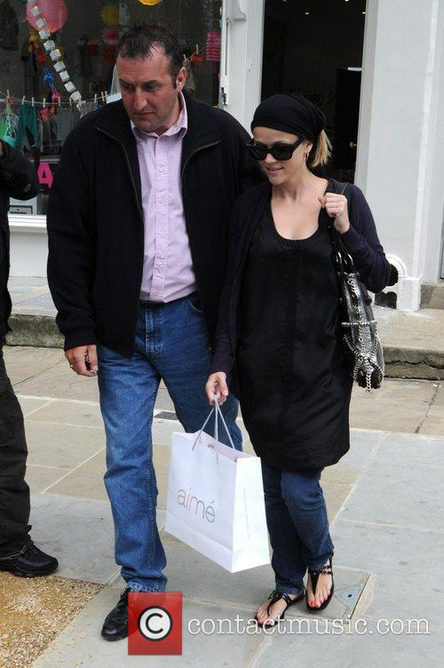 Leaves her new London home, and goes shopping...