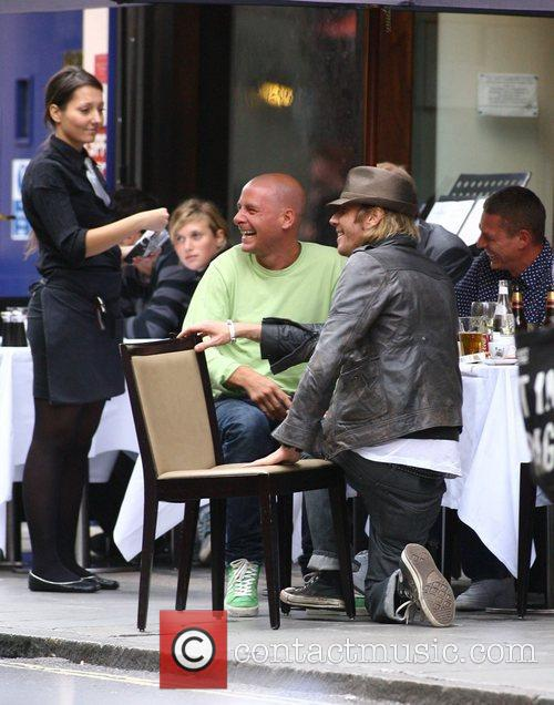 A scruffy looking Rhys Ifans enjoying a few...