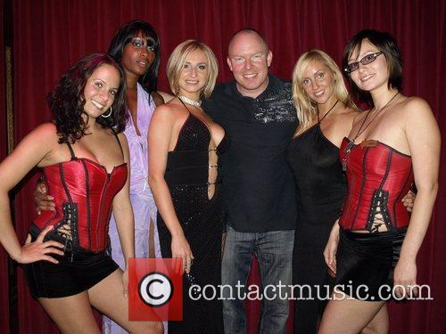 Richard Christy and girl entertainers  attend the...