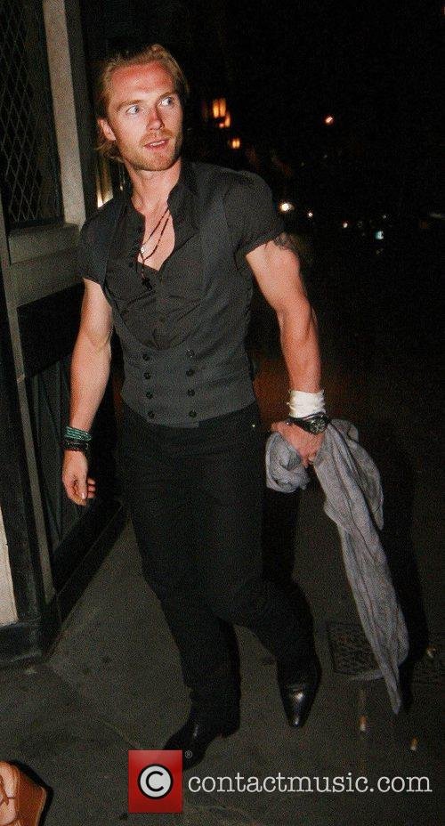 Leaving the Ivy restaurant with his wife. Ronan...