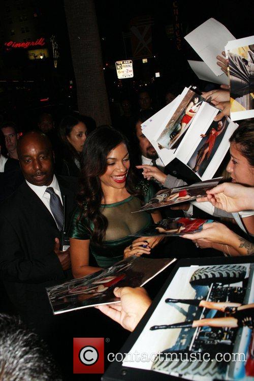 Stops to sign autographs for fans outside the...