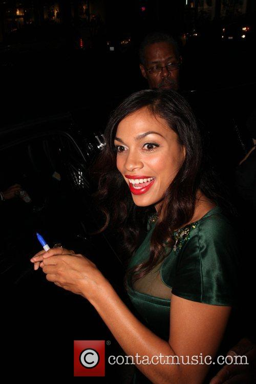 Rosario Dawson  stops to sign autographs for...