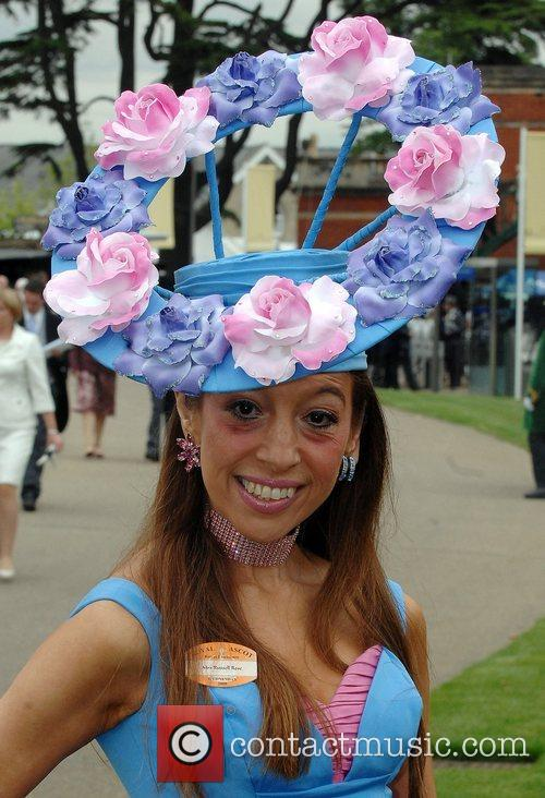 A lady poses for photographers at Royal Ascot