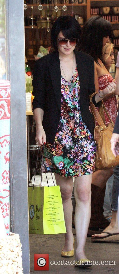 Leaves the Planet Blue shop in Malibu wearing...