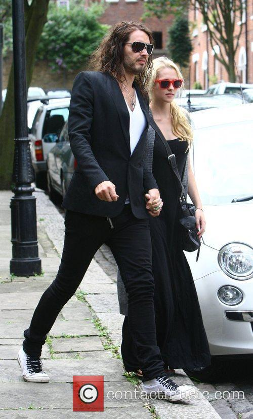 Leaving his London home holding hands. Comedian Brand...