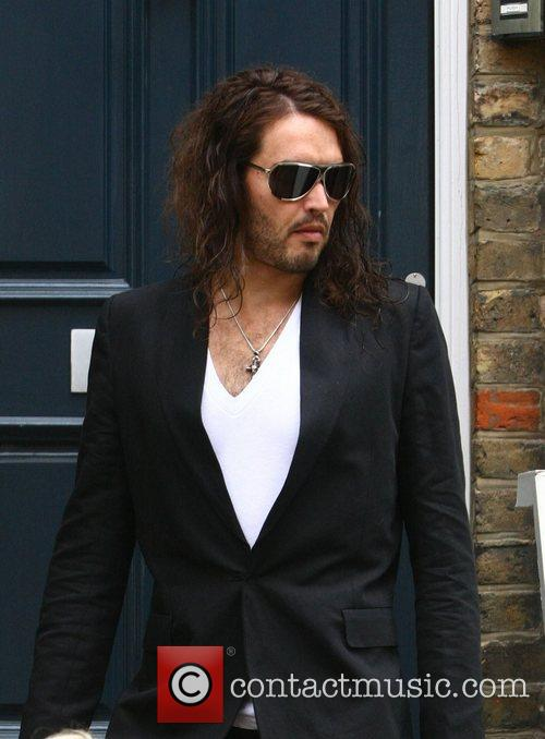 Russell Brand  leaving his London on his...