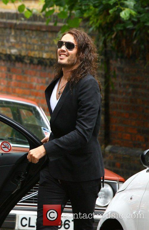 Russell Brand leaving his London home on his...