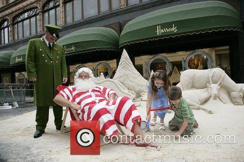 Father Christmas unveils an 8 tonne sand sculpture...