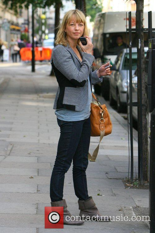 Arrives at the Radio 1 studios with her...