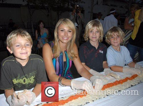 Stacy Keibler and local children Sashi Sushi &...