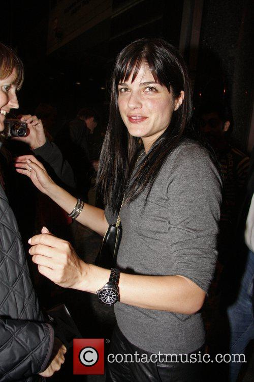 Selma Blair poses with fans when she leaves...
