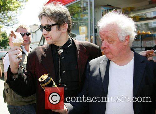 Shane McGowan at Sandycover beach with film director...