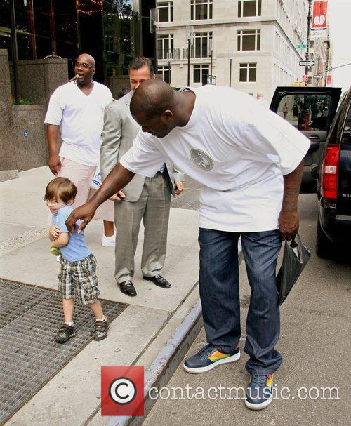 Shaquille O'Neal leaving his hotel in Manhattan and...