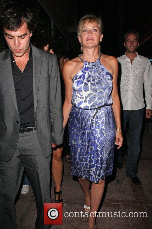 Sharon Stone leaving Beso with a mystery man