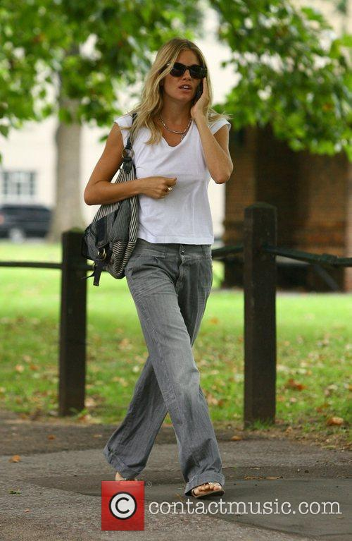 Sienna Miller on her mobile phone as she...