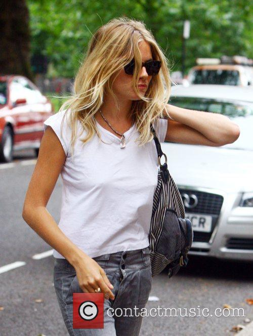 Sienna Miller arriving home after a stroll in...