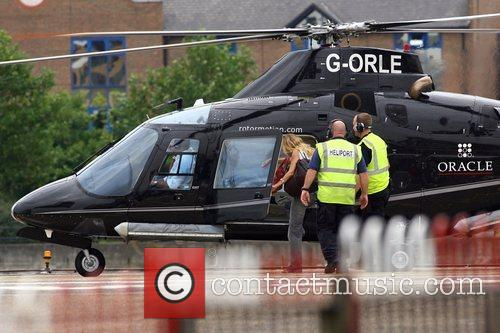 Sienna Miller  climbing aboard a helicopter at...