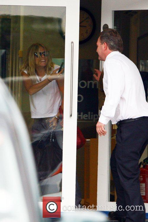 Sienna Miller  arriving to catch a helicopter...
